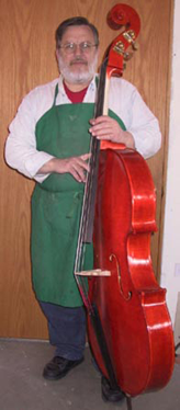 The Master of the shop with a chamber bass violin